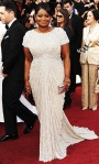 Octavia Spencer in a crystal-embellished Tadashi Shoji gown with Jimmy Choo shoes, Neil Lane jewelry, & a silver Judith Leiber clutch