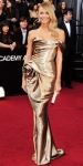 Stacy Keibler in a gold strapless Marchesa sculpted gown