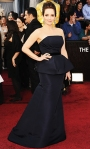 Tina Fey in a black strapless custom Carolina Herrera peplum gown with Bulgari earrings