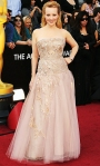 Wendi McLendon-Covey in a lace & tulle CB Haute Couture gown with Simon G jewels & Christian Louboutin clutch & shoes