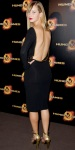 Jennifer Lawrence in a black open-back Tom Ford sheath dress with gold sandals.