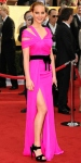 Jennifer Lawrence in a hot pin kOscar de la Renta gown with a Judith Leiber cluth & Roger Vivier satin sandals.