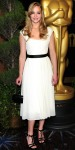 Jennifer Lawrence in a white Chlose dress with beaded satin Roger Vivier sandals.