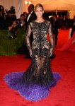 Beyonce in a black & purple cut out lace Givenchy gown