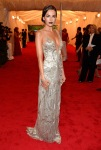 Camilla Belle in a silver plunging Ralph Lauren gown
