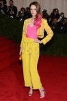 Coco Rocha in a yellow two-piece suit with pink top