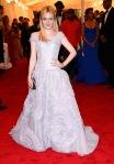 Dakota Fanning in an off the shoulder Louis Vuitton gown