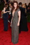 Debra Messing in a silver plunging neckline Kaufmanfranco gown