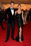 Gisele Bundchen in a black belted gown with Tom Brady