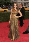 Jessica Alba in a gold one shoulder Michael Kors gown