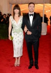 Jessica Biel in a plunging white Prada dress with Justin Timberlake in Tom Ford