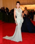 Jessica Stam in a broad shouldered peplum gown by Dior