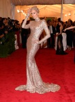 Karolina Kurkova in a gold long sleeved gown by Rachel Zoe