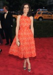 Kristen Wiig in an orange lace 50s inspired gown