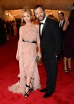 Leslie Mann in a pink Nina Ricci ruffled gown with Judd Apatow