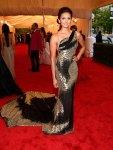 Nina Dobrev in a black & gold Donna Karan gown