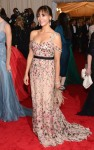 Rashida Jones in a belted floral dress by Tory Burch
