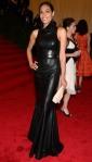 Rosario Dawson in a black leather Calvin Klein gown