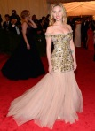 Scarlett Johansson in a gold embellished mermaid cut Dolce & Gabbana gown