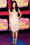 Ashley Greene in a feathered pink dress by Donna Karan Atelier