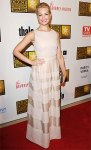 Beth Behrs in a Paule Ka beige column dress