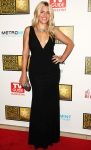 Busy Phillips in a black deep-v Michael Kors dress with an Irene Neuwirth ring
