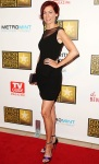 Carrie Preston in a black Cenzig Abazoglu dress with Ryan Haber shoes, a Lauren Merkin clutch, & Lauren Craft earrings