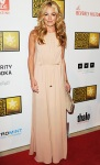 Cat Deeley in a beige column gown by Mulberry