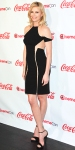 Charlize Theron in a cut-out Dion Lee little black dress & Giuseppe Zanotti heels