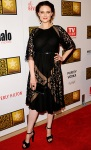 Emily Deschanel in a black BCBGMAXAZRIA dress with sheer lace panetls, a Baccaret ring, & Le Vian earrings