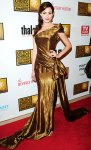Emmy Rossum in a gold one-shoulder Donna Karan shimmering gown