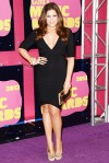 Hillary Scott in a black banded Herve Leger by Max Azria dress with David Webb jewelry