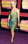Jennie Garth in a one-shoulder Gabriela Cadena cocktail dress