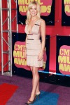 Kellie Pickler in a plunging Herve Leger dress with metallic slingbacks