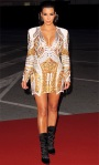Kim Kardashian in a pluning embellished Balmain dress