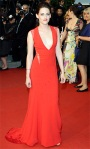 Kristen Stewart in a plunging red Reem Acra gown