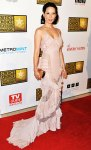 Lucy Liu in a pink Atelier Versace gown & a copper Roger Vivier clutch
