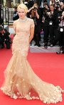 Naomi Watts in an embellished short sleeved Marchesa gown with Chopard jewelry