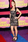 Sarah Darling in a black lace overlay Jovani dress with black sandals