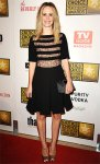 Sarah Paulson in a sheer LBD with lace panels & a Swarovski clutch