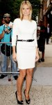 Heidi Klum in a white harness belted dress with platform peep toe pumps.