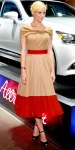 Jaime King in a beige & red colorblock dress with House of Lavande jewelry & ankle strap heels.