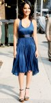 Olivia Munn in a navy belted Raquel Allegra dress with Pomellato 67 earrings, & towering platform sandals.