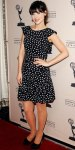 Zooey Deschanel in a black & white polka dot Dolce & Gabban dress with satin round toe pumps.