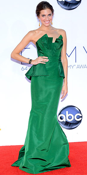 Allison Williams in a green peplum Oscar de la Renta dress with Fred Leighton jewelry.
