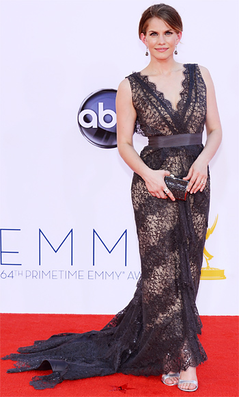 Anna Chlumsky in a tiered lace Christian Siriano scalloped v-neck gown.