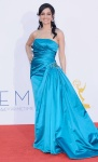 Archie Panjabi in a turquoise Randi Rahm gown with Chopard diamonds.
