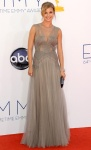 Emily Van Camp in a gray J. Mendel dress with a statement diamond bracelet.