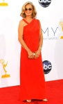 Jessica Lange in a red J.Mendel gown with a Jimmy Choo clutch.
