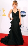 Kathy Griffin in a black halter gown with cascading ruffles & a black cuff.